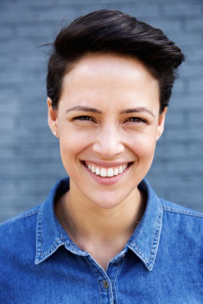 Close up portrait of a young modern woman with short hair smiling